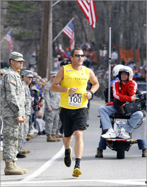 Lance Armstrong ran near the start line of the 112th Boston Marathon.