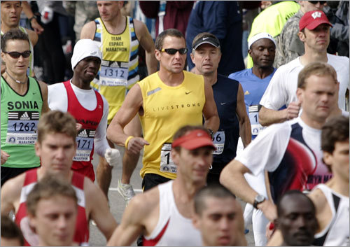 Lance Armstrong ran with hundreds of other marathoners during the race.