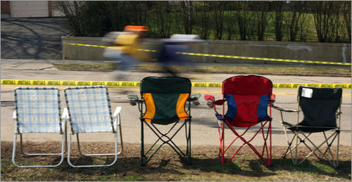Empty chairs reserved a prime-viewing spot for spectators on Commonwealth Avenue at Heartbreak Hill in Newton.