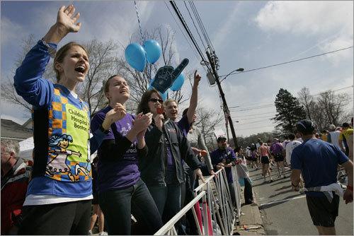 Karabeth Vanick (left) and Emily Clark (right) cheered on the runners in Hopkinton.