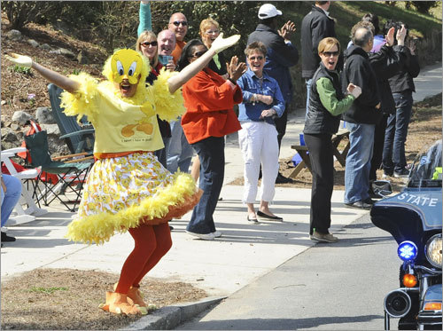 A costumed fan cheered on runners in Natick.