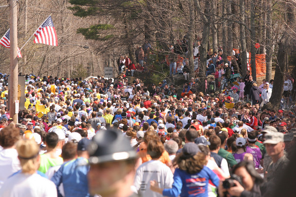 Fans gathered in the trees near the start of the 112th Boston Marathon.