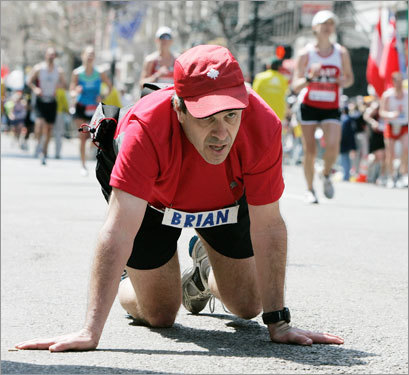 Brian Letourneau, of Gatineau, Canada, crawled the last few feet to the finish line of the Boston Marathon.