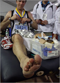 Alan O'Hara , Vancouver, Wash. had his feet tended to in the medical tent after the race.