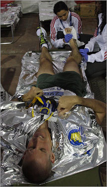 Mark Scherbath, Albuquerque,NM, grimaced in pain in the medical tent after the race.