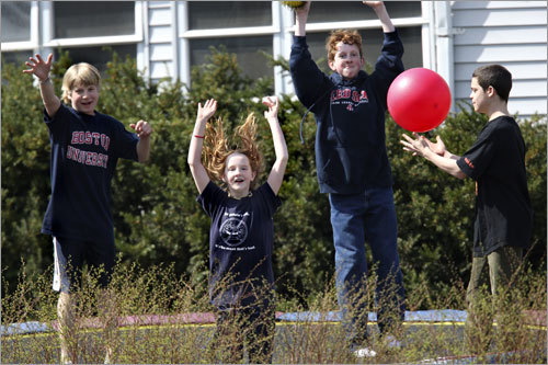 As the lead women approached the 11-mile mark, kids watched while jumping on a trampoline.
