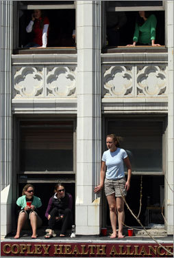 Spectators looked on from their windows near the finish line.