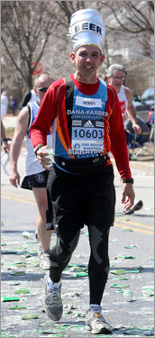 A runner wore a beer hat while participating in the Boston Marathon.