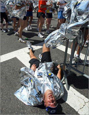Monte Harvill of Frankline, Mich. lay on Boylston Street taking a breather at the finish area.
