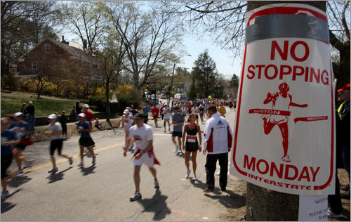 A sign on Commonwealth Avenue in Newton may have been meant for cars, but back-of-the-pack runners seem to be obeying its 'no stopping' message as they climb Heartbreak Hill.