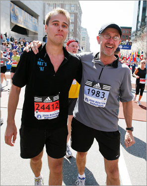 Greg Meyer (right) and his son, Jacob (left) crossed he finish line of the Boston Marathon.