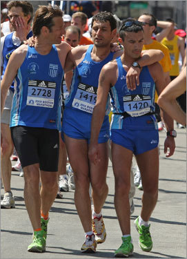 Just past the finish line, Dimitri Petrolakis (left), Vlasios Karavasilis (center), and George Panos (right) ,all from Greece, congratulated each other.