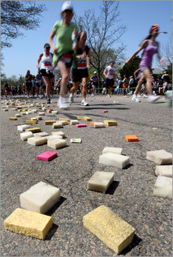 Discarded sponges covered the Commonwealth Ave. pavement at Heartbreak Hill in Newton as runners headed toward Boston.