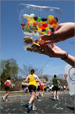 Katie Schmidt handed jelly beans and fig newtons to runners on Heartbreak Hill in Newton.
