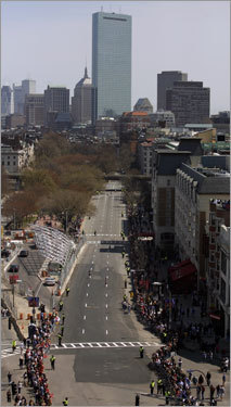 The elite runners stream through Boston's Kenmore Square near the finish of the Boston Marathon.