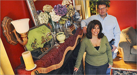 Criss and Todd Robinson of Lynn with some of the items they purchased at yard sales, discount stores, and thrift outlets.