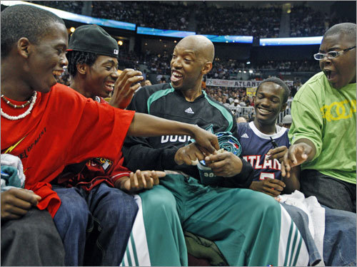 When a malfunctioning 24 second clock delayed the start of the second half, the Celtics' Sam Cassell sat down in the stands with some youngsters from a local Boy's and Girl's Club who had front row seats behind the basket near the Boston bench and had some fun with some of the kids.