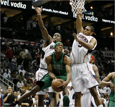 Rajon Rondo struggled to get off a shot under the smothering defense of Al Horford and Joe Johnson.