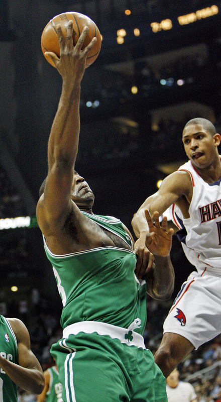 Atlanta's Al Horford gets a handful of shirt while trying to stop Boston's Kendrick Perkins.