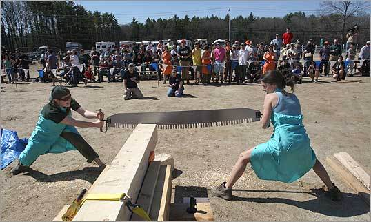 Erica Block (left) and Madeline Gordon, members of the Colby College Woodsmen's team, competed in the Cross Cut to Death competition during the annual Spring Meet, a lumberjack competition held this year at the University of New Hampshire.