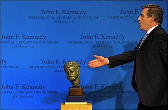 At the JFK Presidential Library & Museum, Prime Minister Gordon Brown of Britain held out his hand to shake with Senator Edward M. Kennedy of Massachusetts, as he walked by a bust of John F. Kennedy.