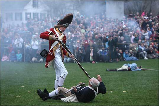 Ian Graves of Chelmsford (left), who portrayed A. Grenadier from the 10th Foot, attacked Minuteman Jonas Parker, portrayed by Jim Hart of Lexington, on the Battle Green in Lexington. The reenactment last week commemorated the 233d anniversary of the first skirmish of the American Revolution.