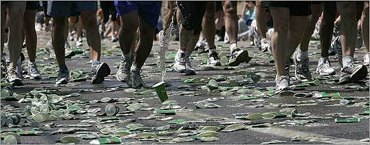 At approximately the 16-mile mark on Washington Street in Newton, the path of the Boston Marathon was a sea of discarded cups.