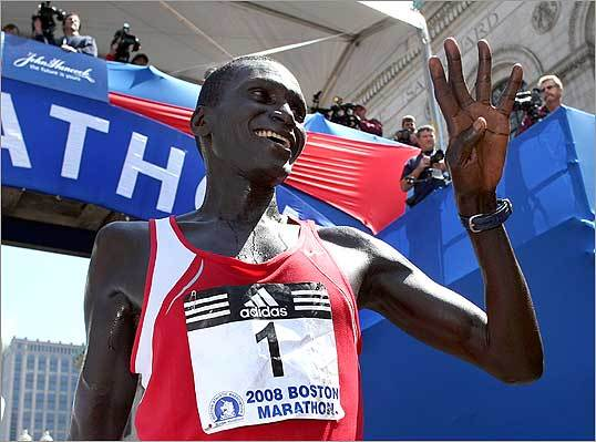 Boston Marathon men's division winner Robert Cheruiyot of Kenya held up four fingers to represent his four marathon victories.