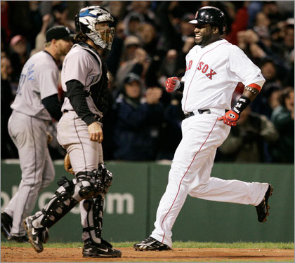 David Ortiz crossed the plate on Youkilis' game-winning hit.