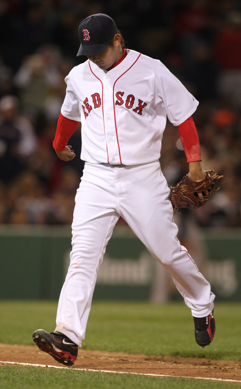 Red Sox pitcher Daisuke Matsuzaka jumps over the first-base line after retiring the side in the sixth inning.