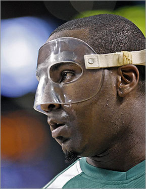 Celtics center Kendrick Perkins wore a mask during the beginning of the game, but later discarded it.