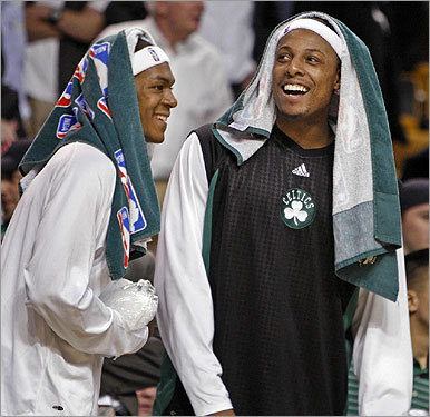 Celtics Paul Pierce (right) and Rajon Rondo shared a laugh from the bench near the end of the game.