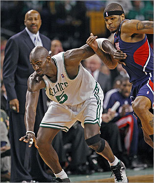 Kevin Garnett showed off his Defensive Player of the Year skills as he tried to keep Josh Smith away as they both chased a second half loose ball.