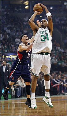 Paul Pierce launched a first quarter shot, despite the best efforts of Mike Bibby.