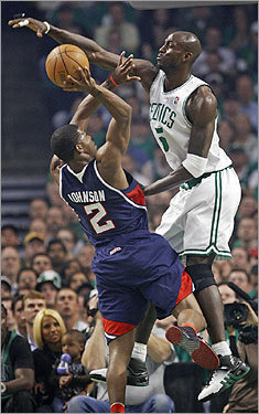 Kevin Garnett attempted to block Joe Johnson's first quarter shot.