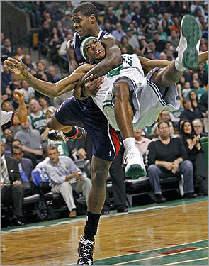 Marvin Williams was ejected from the game after this flagrant foul, tackling Rajon Rondo in the second half.