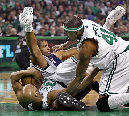 Celtics Sam Cassell (left) and James Posey (right) got tangled up on the floor with Al Horford during a scramble for the ball in the first half.