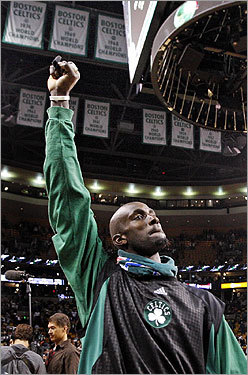 Kevin Garnett raised his fist toward the championship banners hanging from the Garden's rafters as he left the floor following the Celtics' victory.