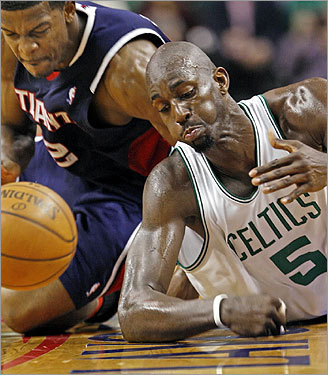 Kevin Garnett hit the parquet as he and Joe Johnson battled for a loose ball in the second half.