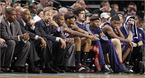 The Hawks coaches and bench watched the Celtics run away with the game.