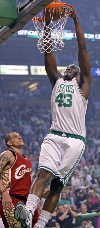 Boston's Kendrick Perkins slams home a first-half dunk.