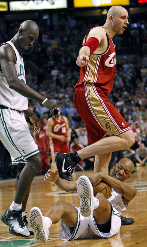 Cleveland's Zydrunas Ilgauskas, right, kneed Sam Cassell, bottom, in the head as he tried to walk over him late in the game.
