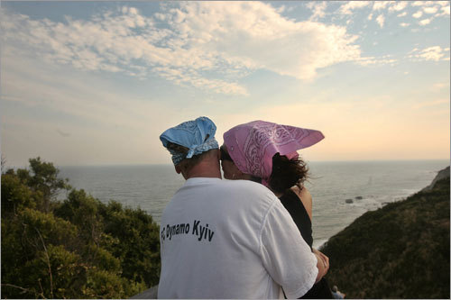 Claus Hertel, left, and his girlfiend Natalia Bruslanova enjoy the view from atop the Mohegan Bluffs.