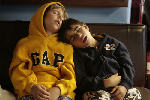 After a day of playing on the beach at Block Island, Jared (left) and his friend Robert sleep on the ferry returning to Point Judith.
