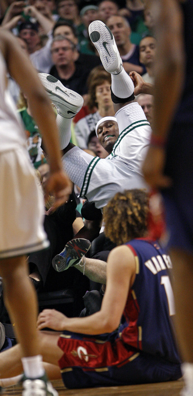 Cleveland's Anderson Varejao gets a good view from the floor as he watches the Celtics' James Posey sail into the seats as he chased a fourth-quarter loose ball.
