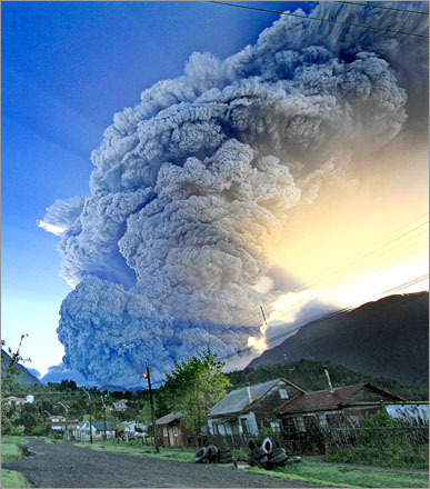 A cloud of smoke and ash fills the sky after the eruption of the Chaiten volcano in southern Chile. The eruption, which began May 2, spewed incandescent material and blasted ash some 20 miles into the Andean sky, forcing authorities into a complete evacuation of the area.