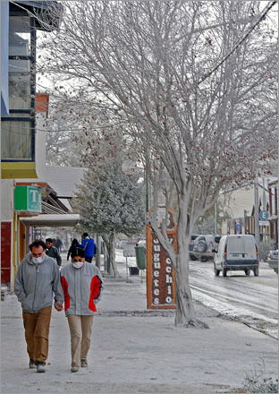 Pedestrians in Esquel, Argentina, make their way through streets covered in ash from the Chaiten volcano in neighboring Chile.