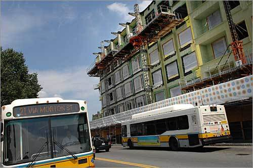 This photo from July 2007 shows buses passing the Carruth on Dorchester Ave.