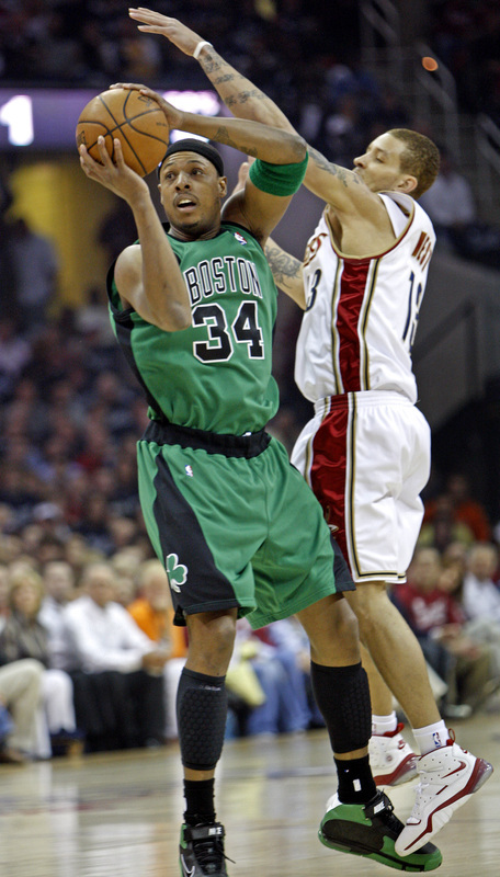 Celtics forward Paul Pierce (34) looks to pass under the defense of Delonte West.