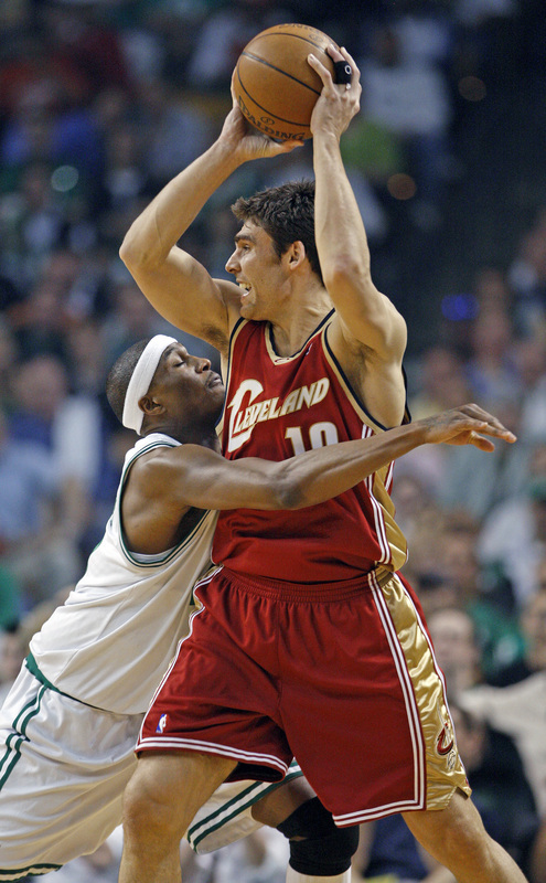 Cavaliers guard Wally Szczerbiak, right, is guarded closely by Celtics forward James Posey.